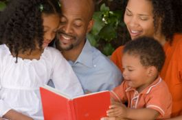 Family preparing for Outer Banks vacation by reading together