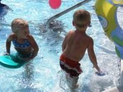 Two kids having fun in a pool in Corolla North Carolina