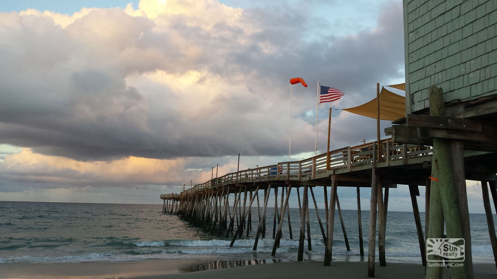 American flag flying high at Avalon Pier